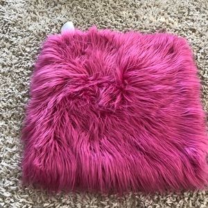 Pink furry pottery barn pillow